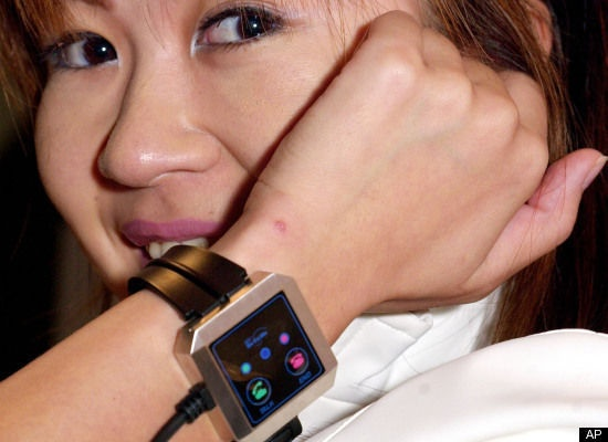 "NTT DoCoMo's prototype ""wearable terminal"" brings us one step closer to being cyborgs. You stick your index finger in your ear to hear and speak through the microphone at the back of the wristband, then snap your fingers to connect or disconnect the call."