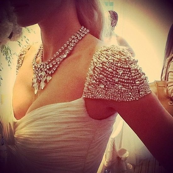 Gorgeous beaded cap sleeve wedding gown.