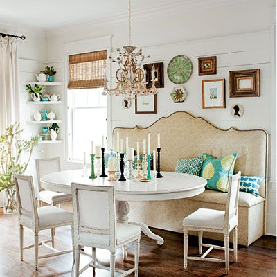 Great little eat-in kitchen area & I always love a bench on one side & a chandelier above ... perfect ... and having the mix of whites & creams adds elegance & depth (I usually like lots of color but this is lovely and pops of color can be added with the pillows, candles, wall hangings or china)