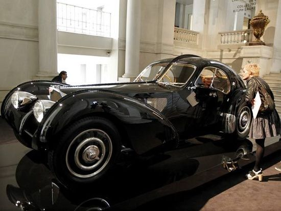 Bugatti Fever: Visitors gaze at a Bugatti 57 SC Atlantic 1938 vintage sport #sport cars #celebritys sport cars #ferrari vs lamborghini #luxury sports cars #customized cars