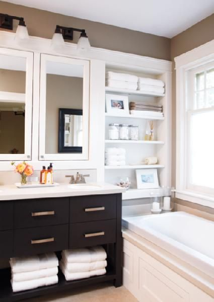 Simple bathroom walk in tile shower instead of tub for master bath.. Love the built in shelves.