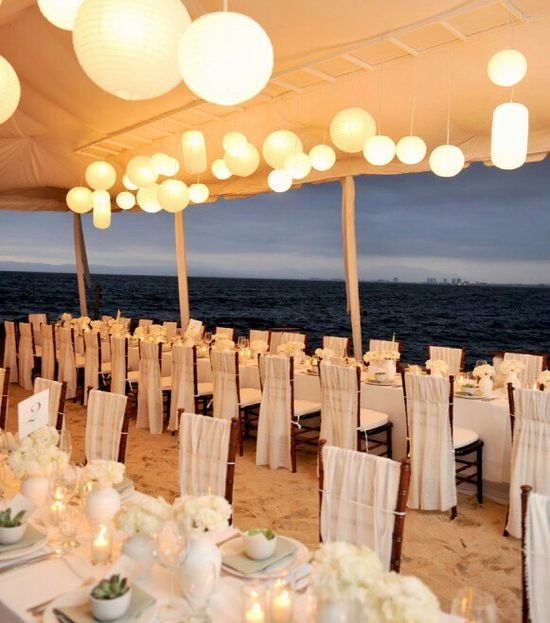 Beach #Wedding Reception with water view under a tent filled with lanterns