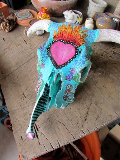 Day of dead sugar skull on real steer skull, handpainted to take advantage of bones' natural shape