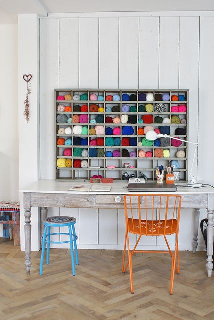 workspace with shelves for colorful wool