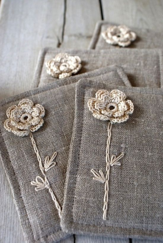 Sewed linen coasters with flower crochet and embroidery