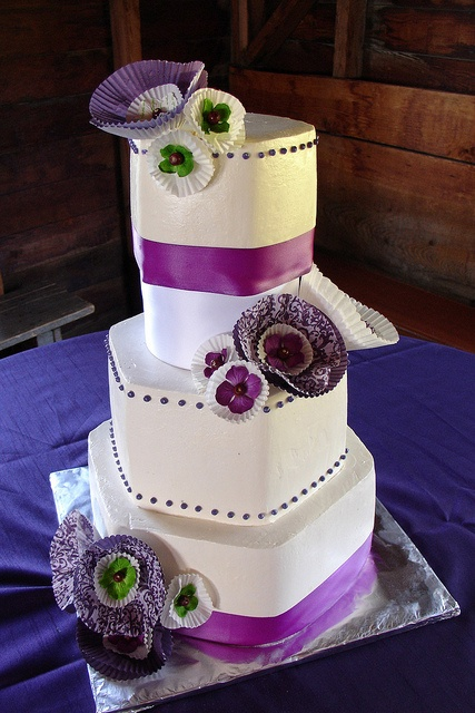 Wedding cake with hexagon tiers and paper flower accents by Sweet Pea Wedding Cakes