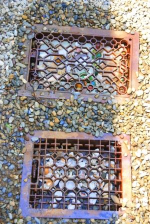 Vintage floor grates in the garden path