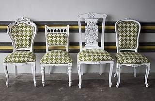 Don't like the fabric, but this is a fun idea - reupholster different thrift store chairs in the same fabric to make a set.