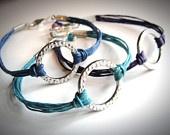 Beachy Blues Harmony bracelets on linen. $18 from JewelryByMaeBee on Etsy.