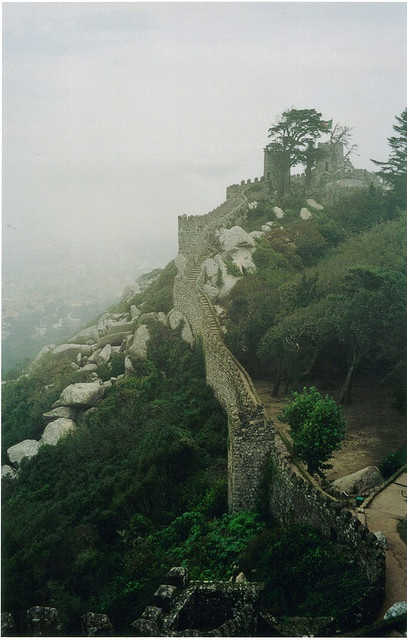 Castelo dos Mouros (Castle of the Moors), Sintra, Portugal. The original castle was built in the 1100s, but after multiple attacks throughout the years, it was completely redone in 1830 by King Ferdinand II. It is built in a Romantic style and forms with the slopes of the land. By Hayden.