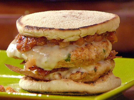 Food Network invites you to try this Turkey Bacon Double Cheese Burgers with Fire Roasted Tomato Sauce recipe from Rachael Ray.