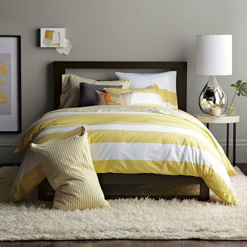 master bedroom ? with small grey pin stripe sheets!