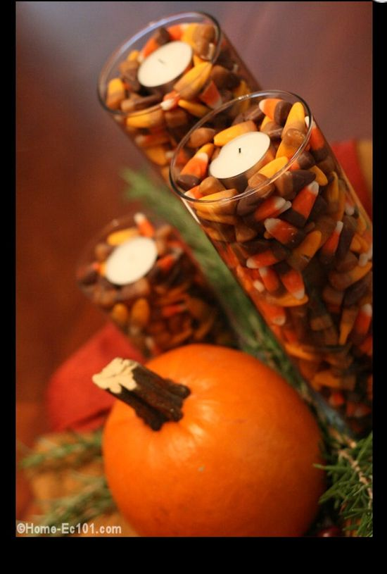 #Thanksgiving centerpieces with candy corn and candles! Grab candy corn on clearance after Halloween.