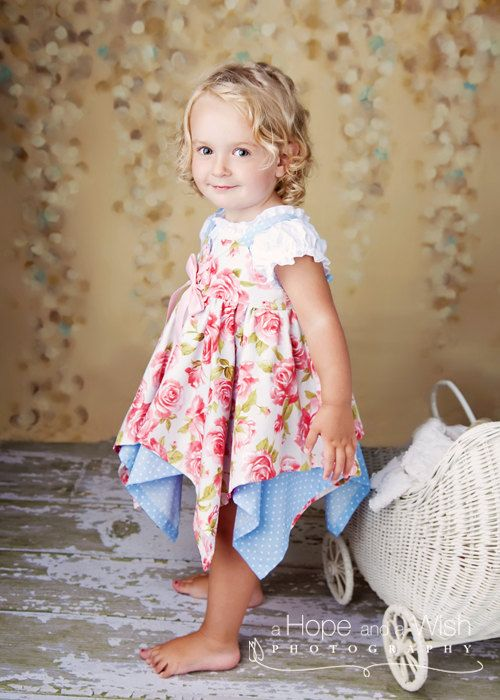 I have made several of these cute little girl dresses already.  Great pattern!