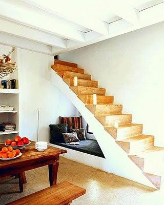 Reading nook hidden under the stairs