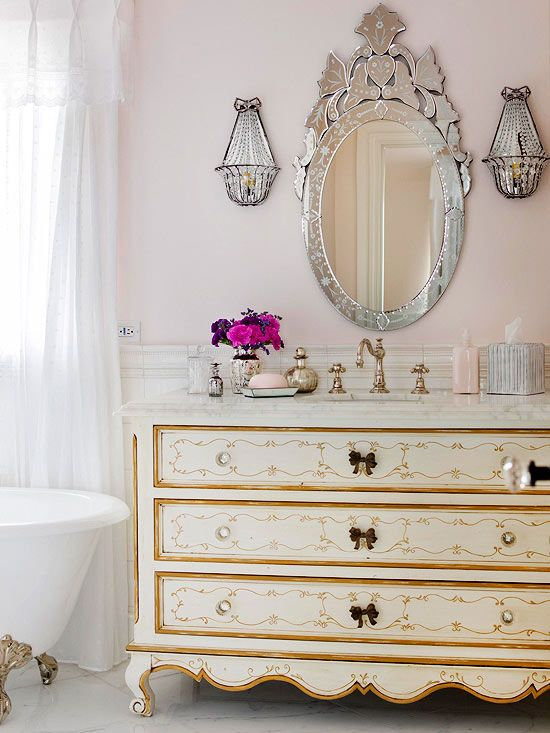 This feminine bathroom uses vintage pieces to bring in a country French flavor. More country French decorating ideas: www.bhg.com/...