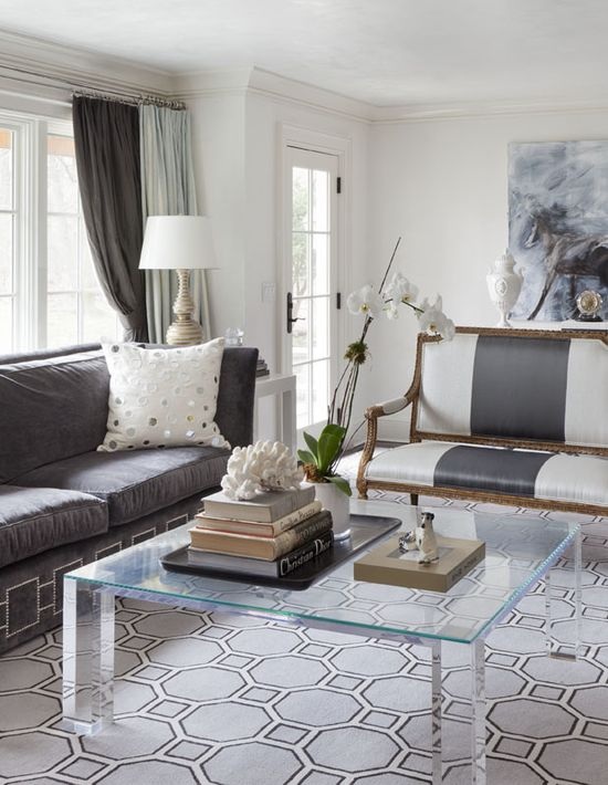 mix of contemporary + classic.  french settee + nailhead sofa + lucite coffee table.