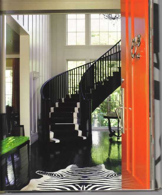 Kelly Wearstler.  Sometimes all you need is a splash of color on the front door.