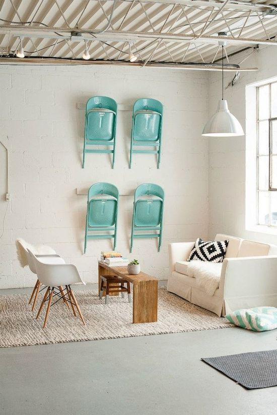 Loving the idea of saving space and hanging the extra chairs on the wall. A lovely color, too! Printerette Studio