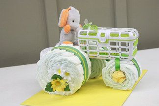 Diaper Tractor - Such a cute - and useful - baby shower gift idea! Perfect for a John Deere or tractor theme. The tractor has 30 diapers, dishwasher basket, pacifier, washcloth, and a stuffed toy.