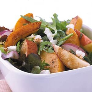 Orange squash and crunchy apples make this a festive side salad for fall.