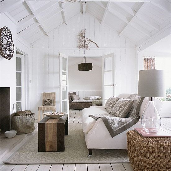 The comfort of white with hints of natural elements and hues. Could relax here all day