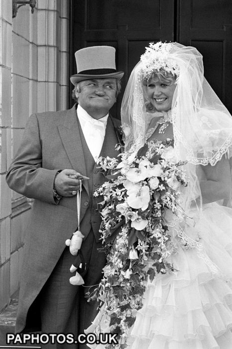 Famous cheeky grin from comedian Les Dawson and his birthday girl bride, former barmaid Tracey Roper after their wedding in Lytham St Annes in Lancashire 1989.