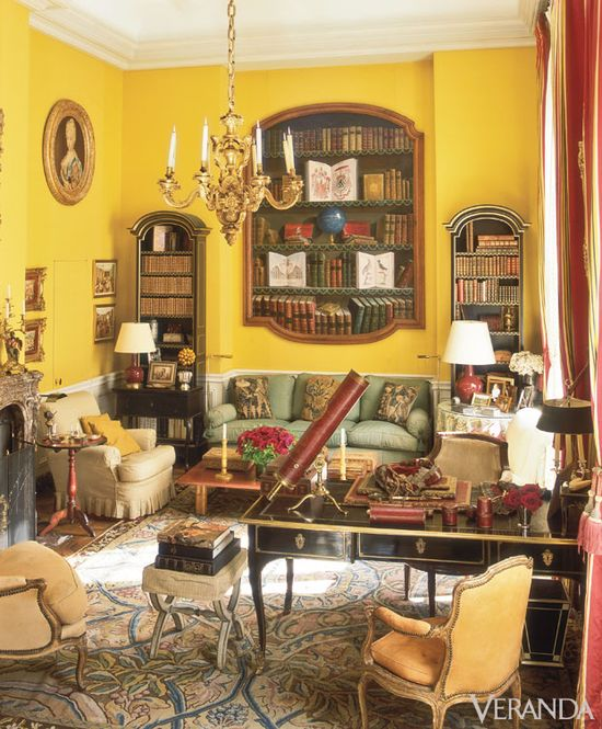 Parisian Panache. Eighteenth-century yellow silk-swathed walls create a sunny reading spot in the library of a Left Bank home...Love the Trompe l'oeil painting of books!