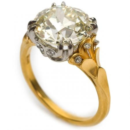 This diamond flora ring from McTeigue & McClelland features an Old European round-cut diamond with rose-cut diamonds in the setting. It is set in 18K bloomed yellow gold and platinum.
