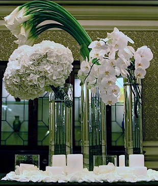 modern flower arrangement with hydrangeas, orchids and large calla lilies
