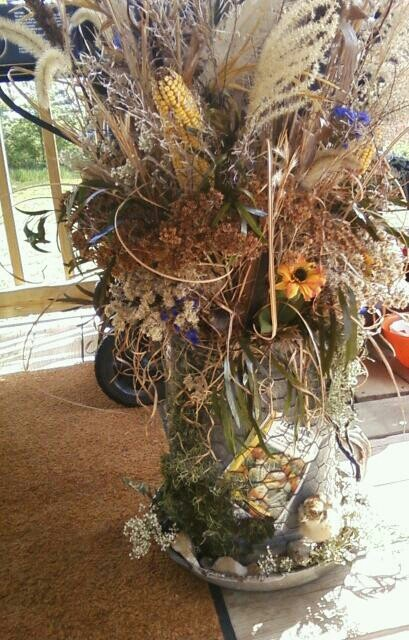Dried flower arrangement made out of chicken waterer by SiLLy GooSe Flowers