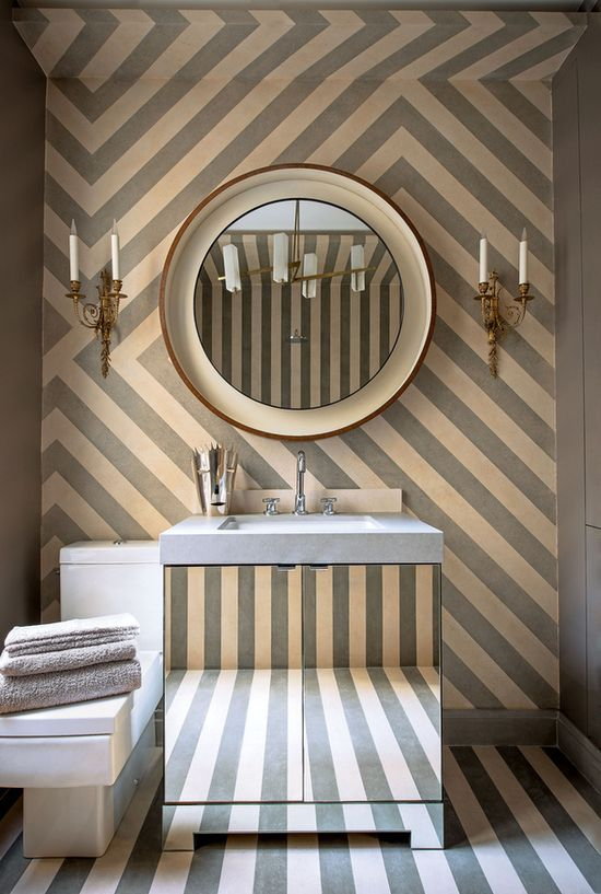 mirrored vanity, patterned wall
