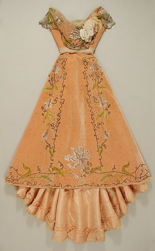 Beaded and embroidered apricot silk velvet ball gown with rhinestone and sequin embellishment and silk floral corsage (front), by Jacques Doucet, French, 1898-1900.