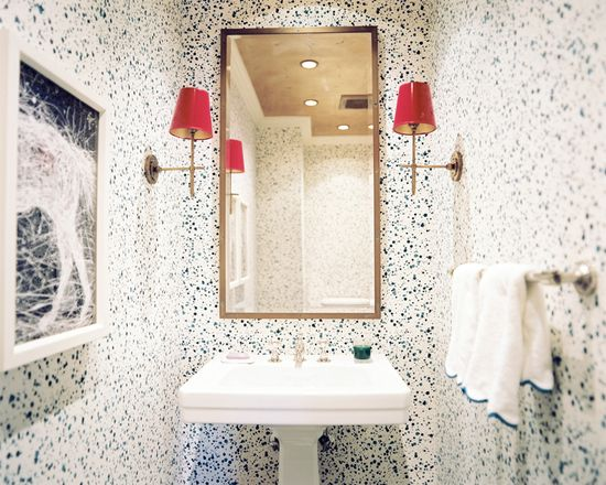 Splatter-paint wallpaper from Hinson & Company make this bathroom a work of art