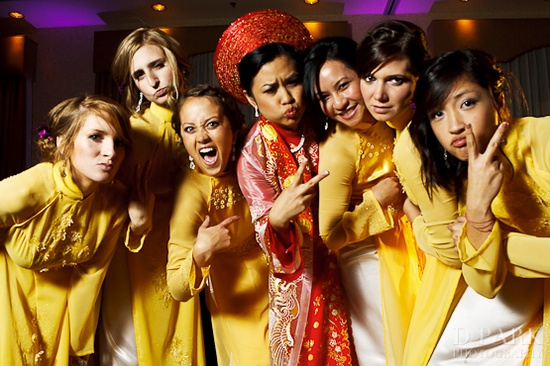 Bridesmaids in cute yellow ao dai with the bride in traditional wedding ao dai