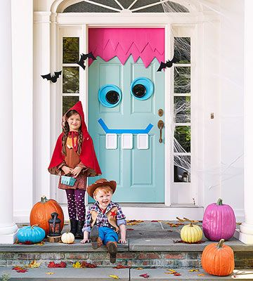 Create some goofy curb appeal with a mischievous monster door for Halloween. Use poster board, plastic plates, and painter's tape to craft his face.