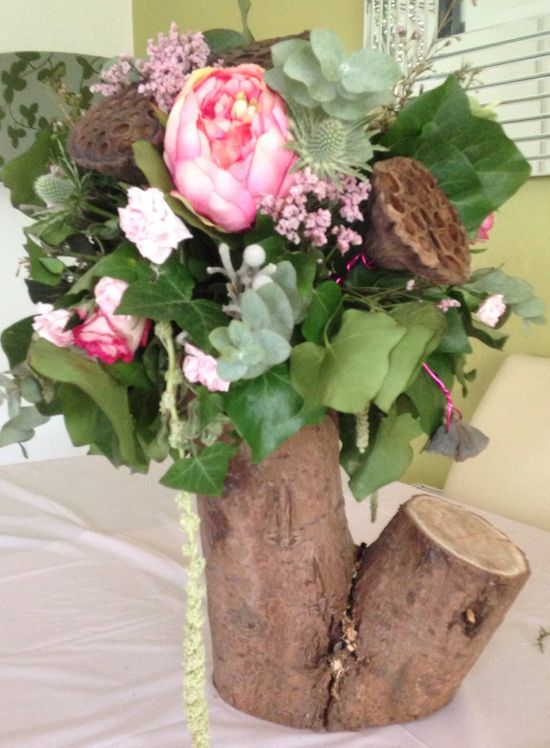 Tree trunk flower arrangement
