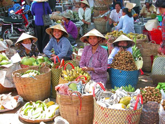 Vietnamese Women at a Market in the Mekong Delta
