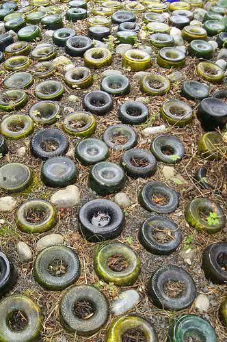 Garden path idea.  Recycling vino bottles!