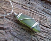 Sea glass jewelry,  Olive green sea glass with sterling silver wrap
