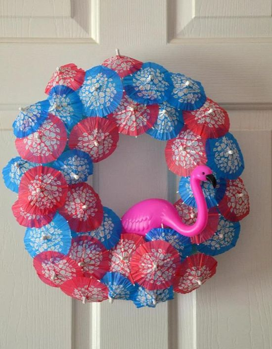 Wreath made out of drink umbrellas! Flamingo Pool Party via Kara's Party Ideas