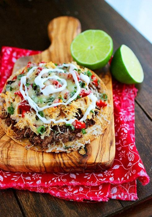 Baked Mexican Tostadas 4 (7 to 8-inch) flour or multigrain tortillas Nonstick cooking spray Chili powder 1 (15 oz.) can black beans, rinsed 2 cups shredded, cooked chicken 3/4 cups diced roasted red peppers 1/2 cup sliced green onions 1 cup Sargento® Shredded Pepper Jack Cheese Salt and pepper, to taste Light sour cream and/or guacamole, for