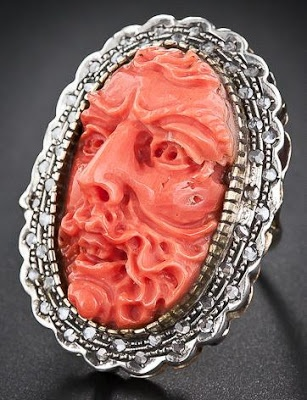 Carved coral and diamond ring. Via Diamonds in the Library.