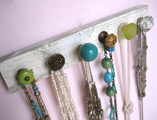 Strip of wood + adorable knobs= super easy jewelry hanger.
