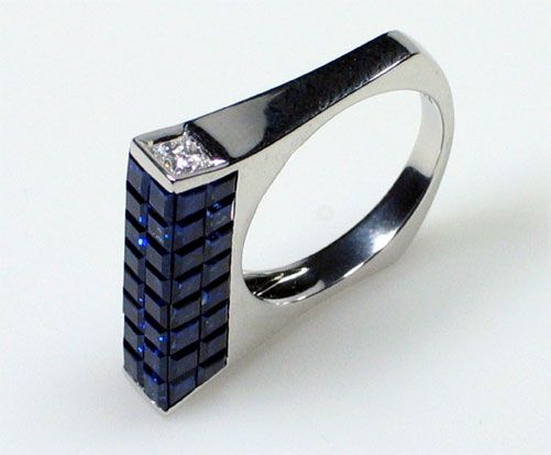I have a thing for invisible set sapphires... and this ring is just super cool.  Art Deco meets Architectural