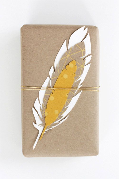 wrapping: brown paper & layered paper feather