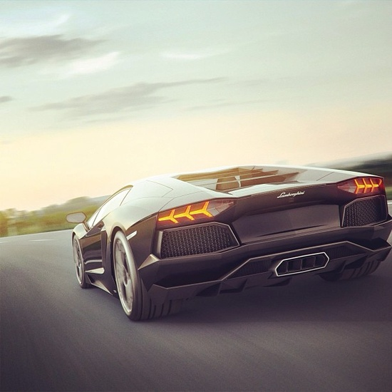 Lamborghini Aventador driving into the sunset