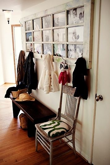 old door with pictures and coat hooks. Love this! @ Do It Yourself Remodeling Ideas