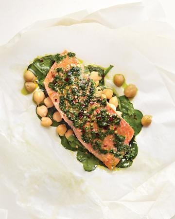 salmon fillets in parchment with spinach and chickpeas...  and paste of parsley, garlic, and olive oil.