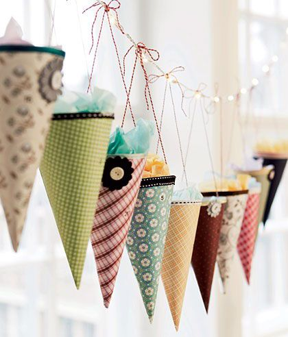 cone garland  christmas theme..or kids birthday party garland, and favors.  use paper, or masa/watercolor paper washes.. last years christmas cards/ lace *cover a paper mold with plastic wrap and stiffener in lace*